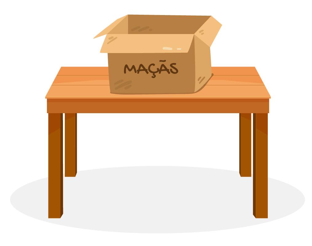 Caixa de maçãs colocada em cima de uma mesa.